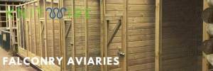 row of falconry aviaries made of wood and clearmesh