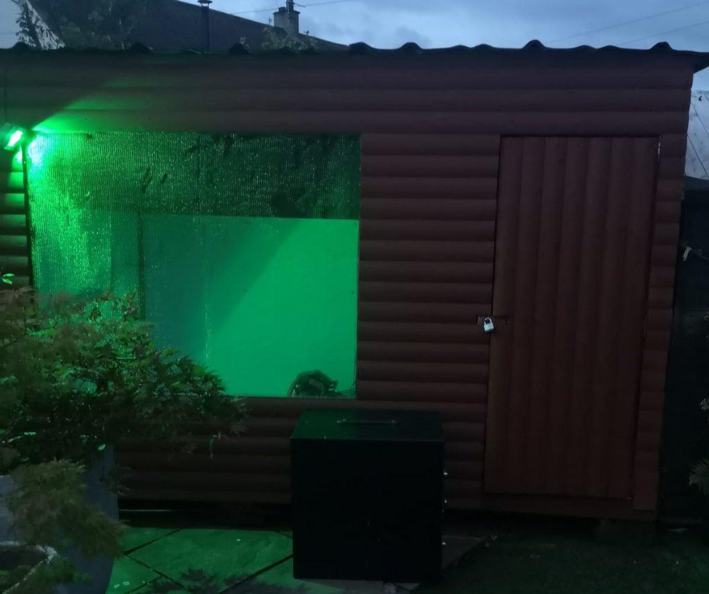 green light shining on falconry aviary