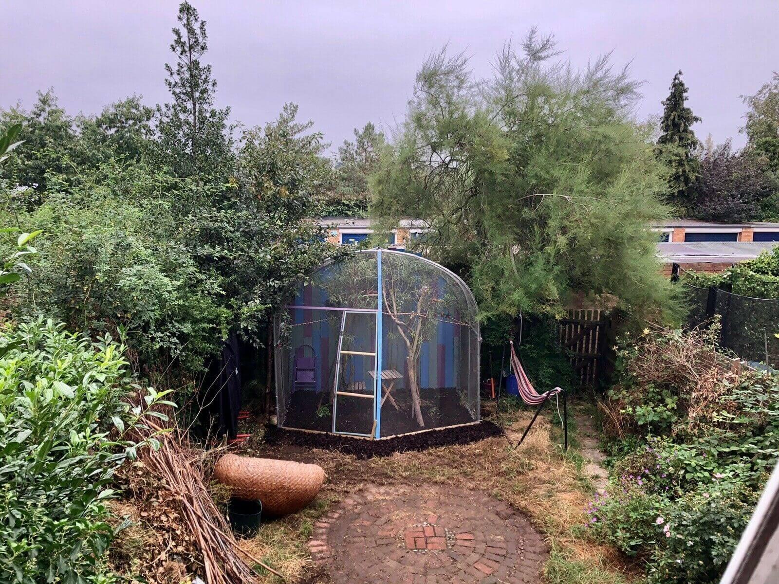 Small bird aviary enclosure in back garden