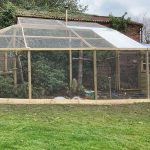 Large wooden outdoor mixed aviary